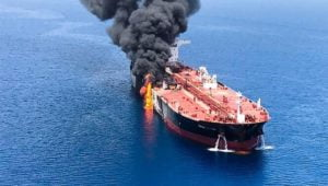 Why would Iran attack two tankers near the Strait of Hormuz?