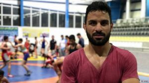 Iran arrests father and brother of executed wrestler while cleaning grave